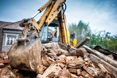 Hydraulic crusher excavator backoe machinery working on site Stock Photo