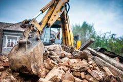 Hydraulic crusher excavator backoe machinery working on site Stock Photo