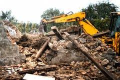 Hydraulic crusher, industrial excavator machinery working Stock Image