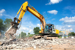 Hydraulic crusher at site demolition Stock Photo