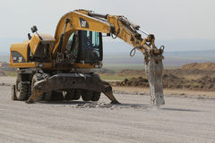 Hydraulic crushing hammer breaking concrete on a runway construction site Stock Images
