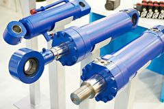 Hydraulic cylinders. On stand exhibition royalty free stock photography