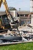 Hydraulic Demolition Machine. School being demolished stock image