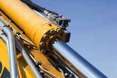 Hydraulic detail. Close-up of a hydraulic cylinder, pipes and hoses on heavy machinery stock photo