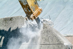 Hydraulic digger breaking up a wall Royalty Free Stock Images