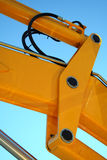 Hydraulic element of a yellow boom of a tractor Stock Photos