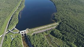 Dam on the River. Aerial View. Hydraulic Engineering Structure Located near Kandalaksha Town in Nothern Russia on River Niva royalty free stock photo