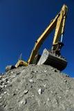 Hydraulic excavator. Yellow hydraulic excavator at work royalty free stock photos