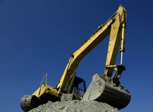 Hydraulic excavator. Wide view of an hydraulic excavator at work royalty free stock images