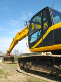 Hydraulic excavator. Different shoots of the hydraulic excavator (yellow and black Royalty Free Stock Photos