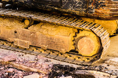 Hydraulic Excavator Shoe And Track Frame. Detail image of the shoe and track frame of an hydraulic excavator working on a shoreline in the sea water. Photo taken stock images