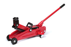 Hydraulic floor jack. Red hydraulic floor jack isolated on white background stock photos