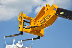 Hydraulic forklift and sky Royalty Free Stock Image