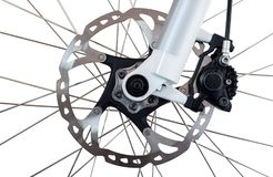 Hydraulic front disc brake on mountain bike. Isolated on a white background. Hydraulic front disc brake on mountain bike. Isolated on a white background royalty free stock image