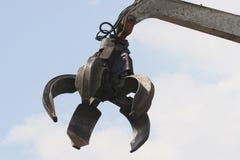 Hydraulic Grabber. Industrial grabber in scrap metal facility Stock Photo