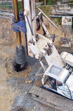 Hydraulic hammer drilling machine at construction site Stock Images