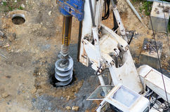 Hydraulic hammer drilling machine at construction site Royalty Free Stock Photos
