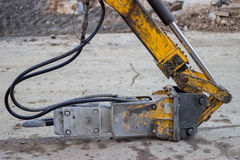 Hydraulic hammer head on building site Royalty Free Stock Image