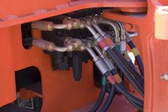 Hydraulic hoses. A closeup of some hydraulic hoses on a tractor Royalty Free Stock Image