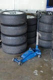 Hydraulic jacks tires stack Stock Photography