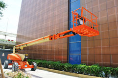 Hydraulic Lift. The image of an orange hydraulic lift royalty free stock photos