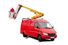 Hydraulic lift. A car with hydraulic lift and a man who is working on it Stock Photos