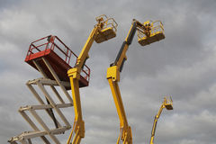 Hydraulic Lift Machines. Against stormy sky stock photos