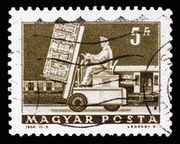 Hydraulic lift truck & mail car, Transport and Telecommunication serie, circa 1964. MOSCOW, RUSSIA - SEPTEMBER 15, 2018: A stamp printed in Hungary shows stock photo