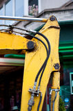 Hydraulic mechanism. Yellow and dirty piece of hydraulic machinery Royalty Free Stock Photos