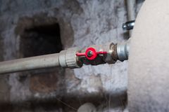 Hydraulic pipes an valves in basement Stock Image