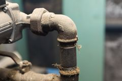 Hydraulic pipes an valves in basement Royalty Free Stock Images