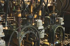 Hydraulic and pneumatic control unit of an old historical crane that is no longer in operation and is slowly rotting away, stock photos