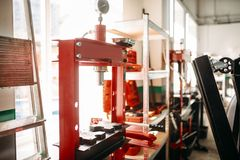 Hydraulic press in car service , nobody. Professional auto-service tools and equipment for pressing parts royalty free stock image