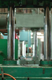 Hydraulic press at factory. Vertical hydraulic press at factory. Shallow depth of field, background blurred Stock Images