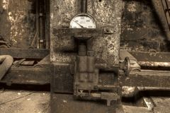 Hydraulic press with gauge. An old hydraulic press with a gauge Stock Photos