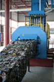 Hydraulic press in recycling plant. Bale of waste plastic on hydraulic press in recycling plant. The plastic is separated from household waste royalty free stock images