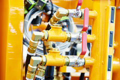 Hydraulic pressure pipes and connection fittings of industrial equipment Stock Photos