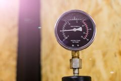Hydraulic shop press analog gauge and osb on background royalty free stock photography