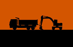 Hydraulic shovel and lorry silhouette vecto Royalty Free Stock Photography