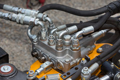 Hydraulic system in agricultural machinery. Close up of pipe system of hydraulic valves in agricultural machinery Stock Photos