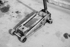 Hydraulic trolley for moving cargo black and white photo Stock Photography