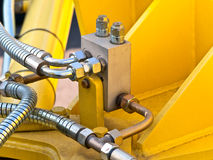 Hydraulic tubes. Photo of hydraulic tubes against yellow royalty free stock photography