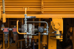Hydraulic tubes, fittings and levers on control panel of lifting Royalty Free Stock Photos