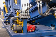 Hydraulic tubes, fittings and levers on control Stock Photography