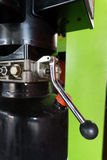 Hydraulic tubes, fittings and levers on control panel of lifting Royalty Free Stock Photography