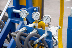 Hydraulic tubes, fittings and manometers on control panel Royalty Free Stock Photo