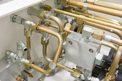 Hydraulic Tubes. Multiple Hydraulic Tubes and Fittings on Hydraulic Equipment Royalty Free Stock Photography