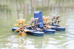 Hydraulic water turbine for increasing oxygen in pond the water, Thailand. stock image