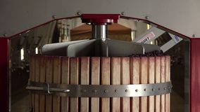 Hydraulic wine press mixing during fermentation process in barrel or tank