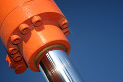 Hydraulics. A close up of a hydraulic ram against a blue sky royalty free stock photography